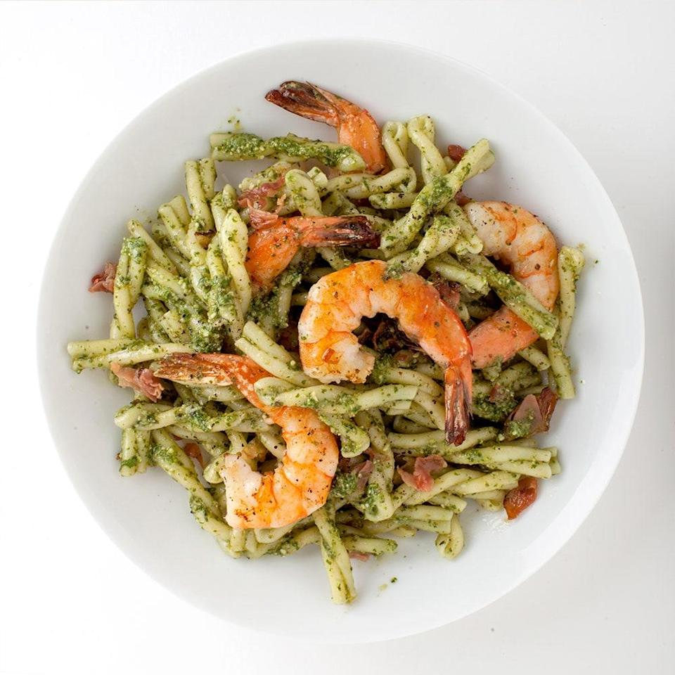 """A version of this recipe helped chef Danny Bowien win the Pesto World Championship in Italy in 2008. He was kind enough to let us adapt it a bit. <a href=""""https://www.bonappetit.com/recipe/pasta-with-pesto-shrimp-and-cured-ham?mbid=synd_yahoo_rss"""" rel=""""nofollow noopener"""" target=""""_blank"""" data-ylk=""""slk:See recipe."""" class=""""link rapid-noclick-resp"""">See recipe.</a>"""
