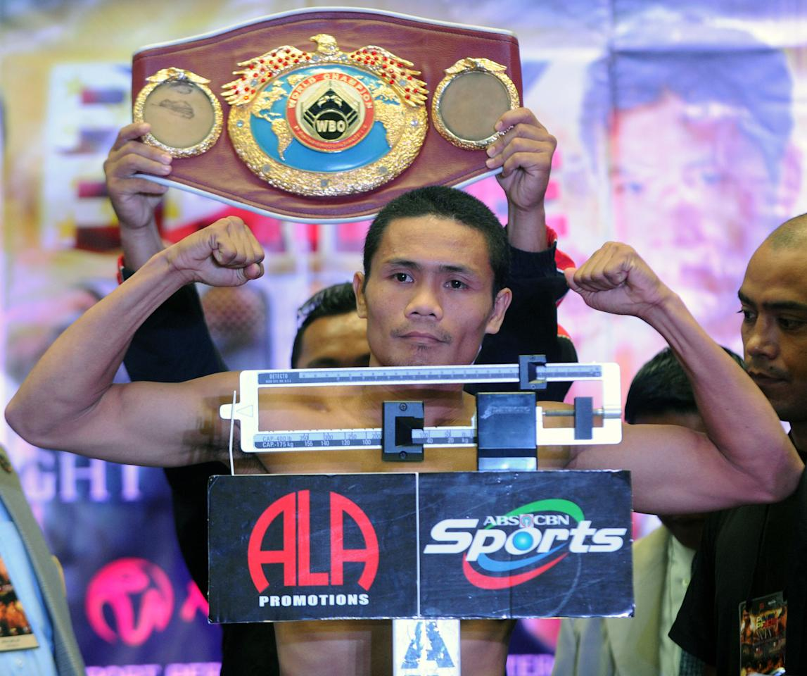 World Boxing Organisation light-flyweight champion Donnie Nietes of the Philippines flexes his muscles at the official weigh-in on June 1, 2012 in Manila.  Nietes will stake his title against Mexican challenger Felipe Salguero on June 2.   AFP PHOTO / Jay DIRECTOJAY DIRECTO/AFP/GettyImages