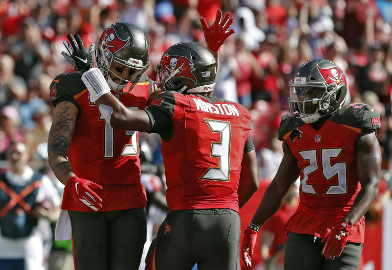 The Buccaneers' new uniforms haven't been popular since their 2014 release. (AP Photo/Mark LoMoglio)