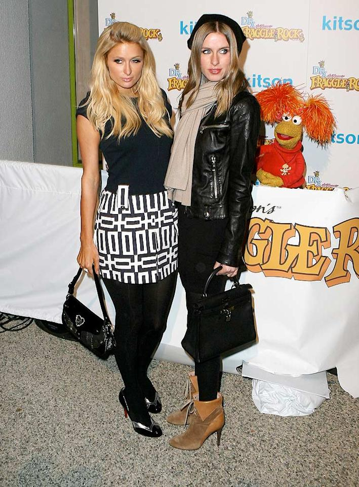 "Paris and Nicky Hilton strike a pose at the Dr. Romanelli Fraggle Rock Clothing Collaboration at the trendy Kitson boutique. The event was a toy drive to benefit the LA Mission. Ice-MVP/<a href=""http://www.x17online.com"" target=""new"">X17 Online</a> - December 9, 2009"