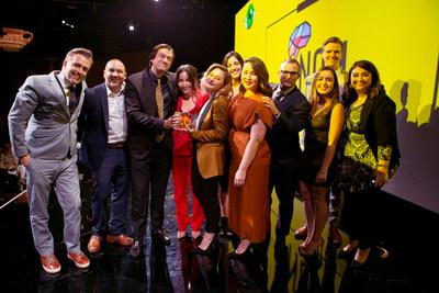 Pictured from left to right: Presenter Jeremy Delaplane with Robert Figueroa, Brent Neill, Hilary Lassoff, Loren Rochelle, Rebecca Treadwell, Cyndi Otteson, Buck Jensen, Brianna Medina, Christopher McMahon, and Arrianna Hamrah accepting the 'Startup of the Year' award by ThinkLA for NOM. (Photo credit: Christie Evans)