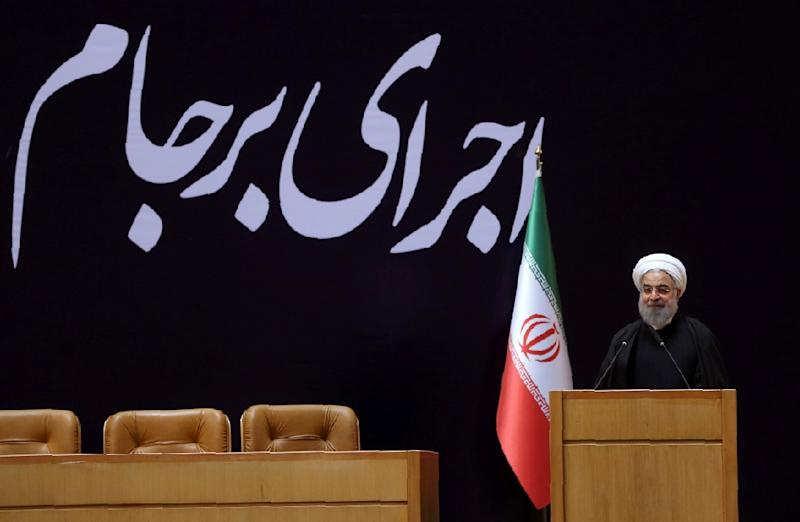 """Iranian President Hassan Rouhani delivers a speech during a conference entitled """"Implementation of Joint Comprehensive Plan of Action (JCPOA) a new chapter in Iran's economy"""", on January 19, 2016, in Tehran (AFP Photo/STRINGER)"""