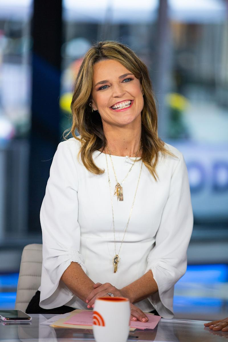Savannah Guthrie smiles sitting at the Today Show news desk