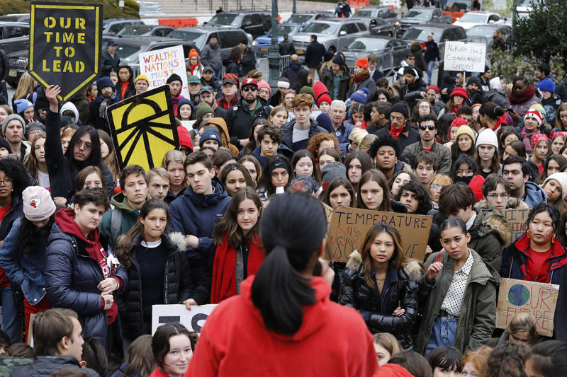 A crowd of hundreds listens to a speaker during a climate rally coinciding with protests in Madrid, where United Nations-sponsored talks on climate change are underway.