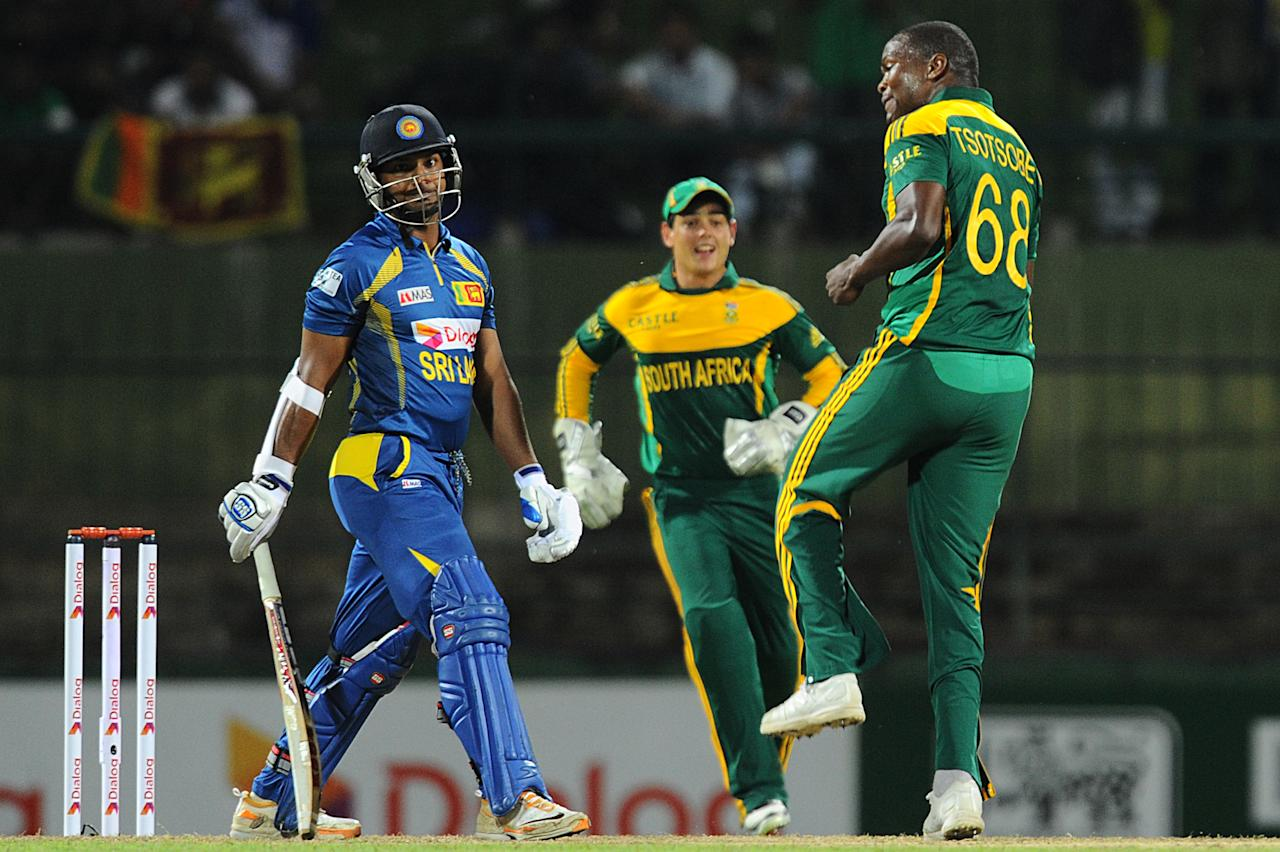 South African cricketers Lonwabo Tsotsobe (R) celebrates the wicket of Sri Lankan cricketer  Kumar Sangakkara (L) during the third One Day International (ODI) cricket match between Sri Lanka and South Africa at the Pallekele International Cricket Stadium in Pallekele on July 26, 2013. AFP PHOTO/ Ishara S.KODIKARA        (Photo credit should read Ishara S.KODIKARA/AFP/Getty Images)
