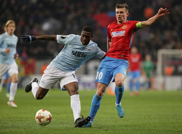 Soccer Football - Europa League Round of 32 First Leg - Steaua Bucharest vs Lazio - National Arena, Bucharest, Romania - February 15, 2018 Lazio's Bastos in action with Steaua Bucharest's Florin Tanase Inquam Photos/Octav Ganea via REUTERS ROMANIA OUT. NO COMMERCIAL OR EDITORIAL SALES IN ROMANIA THIS IMAGE HAS BEEN SUPPLIED BY A THIRD PARTY. IT IS DISTRIBUTED, EXACTLY AS RECEIVED BY REUTERS, AS A SERVICE TO CLIENTS