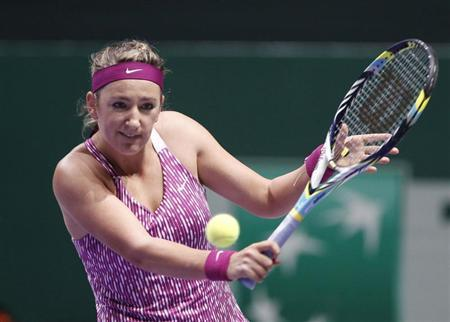 Victoria Azarenka of Belarus hits a return to Li Na of China during their WTA tennis championships match at Sinan Erdem Dome in Istanbul
