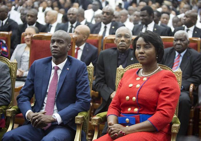 Haiti's President Jovenel Moise sits with his wife Martine during his swearing-in ceremony at Parliament in Port-au-Prince, Haiti, Tuesday Feb. 7, 2017. Moise was sworn-in as president for the next five years after a bruising two-year election cycle, inheriting a struggling economy and a deeply divided society. (AP Photo/Dieu Nalio Chery)