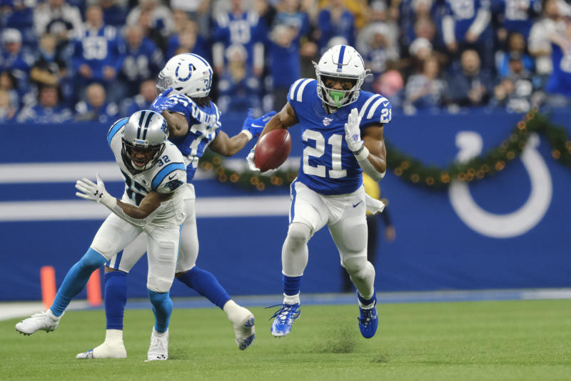 Indianapolis Colts running back Nyheim Hines (21) runs back a punt for a touchdown during the second half of an NFL football game against the Carolina Panthers, Sunday, Dec. 22, 2019, in Indianapolis. (AP Photo/AJ Mast)