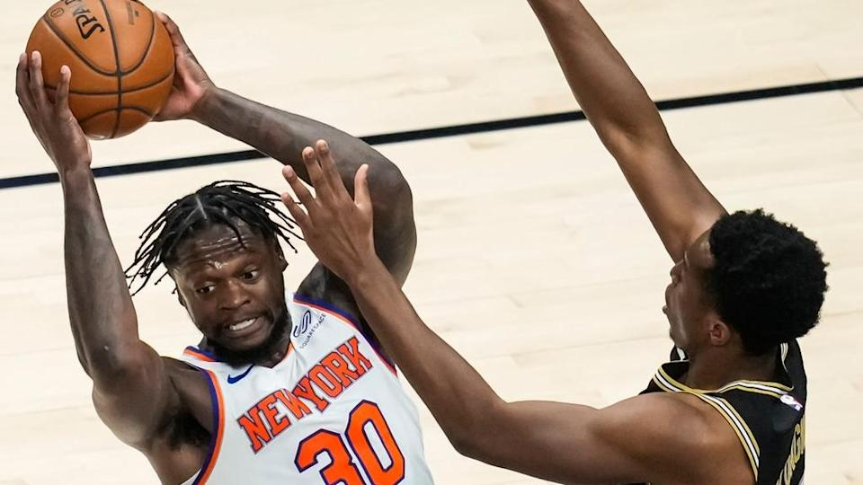 Julius Randle looks to pass with Hawks guarding