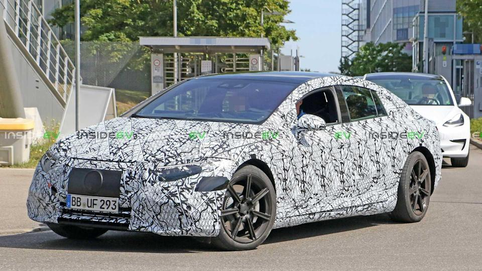 """<p>Mercedes' upcoming flagship EV hits the road for development with a <a href=""""https://www.motor1.com/tesla/model-s/"""" rel=""""nofollow noopener"""" target=""""_blank"""" data-ylk=""""slk:Tesla Model S"""" class=""""link rapid-noclick-resp"""">Tesla Model S</a> along as a benchmark. When it arrives, the vehicle's range could exceed 435 miles.</p> <h3><a href=""""https://www.motor1.com/news/436440/mercedes-benz-eqs-spy-shots/"""" rel=""""nofollow noopener"""" target=""""_blank"""" data-ylk=""""slk:Mercedes-Benz EQS EV Spied Testing With Teslas"""" class=""""link rapid-noclick-resp"""">Mercedes-Benz EQS EV Spied Testing With Teslas</a></h3> <h2>EQS News:</h2><br><a href=""""https://www.motor1.com/news/434765/mercedes-eqs-435-miles-range/"""" rel=""""nofollow noopener"""" target=""""_blank"""" data-ylk=""""slk:2022 Mercedes EQS Electric Sedan To Offer More Than 435 Miles Of Range"""" class=""""link rapid-noclick-resp"""">2022 Mercedes EQS Electric Sedan To Offer More Than 435 Miles Of Range</a><br><a href=""""https://www.motor1.com/news/408083/mercedes-amg-eqs-sedan-rumor/"""" rel=""""nofollow noopener"""" target=""""_blank"""" data-ylk=""""slk:Mercedes-AMG EQS Electric Performance Sedan Coming With 600+ HP?"""" class=""""link rapid-noclick-resp"""">Mercedes-AMG EQS Electric Performance Sedan Coming With 600+ HP?</a><br>"""