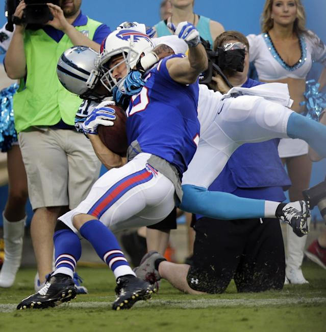 Buffalo Bills' Chris Hogan, front, is tackled by Carolina Panthers' Thomas DeCoud, back, during the first half of a preseason NFL football game in Charlotte, N.C., Friday, Aug. 8, 2014. (AP Photo/Chuck Burton)