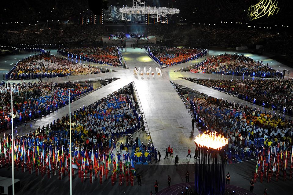 Athletes gather in the centre of the stadium during the Closing Ceremony on Day 16 of the London 2012 Olympic Games at Olympic Stadium on August 12, 2012 in London, England. (Photo by Michael Regan/Getty Images)