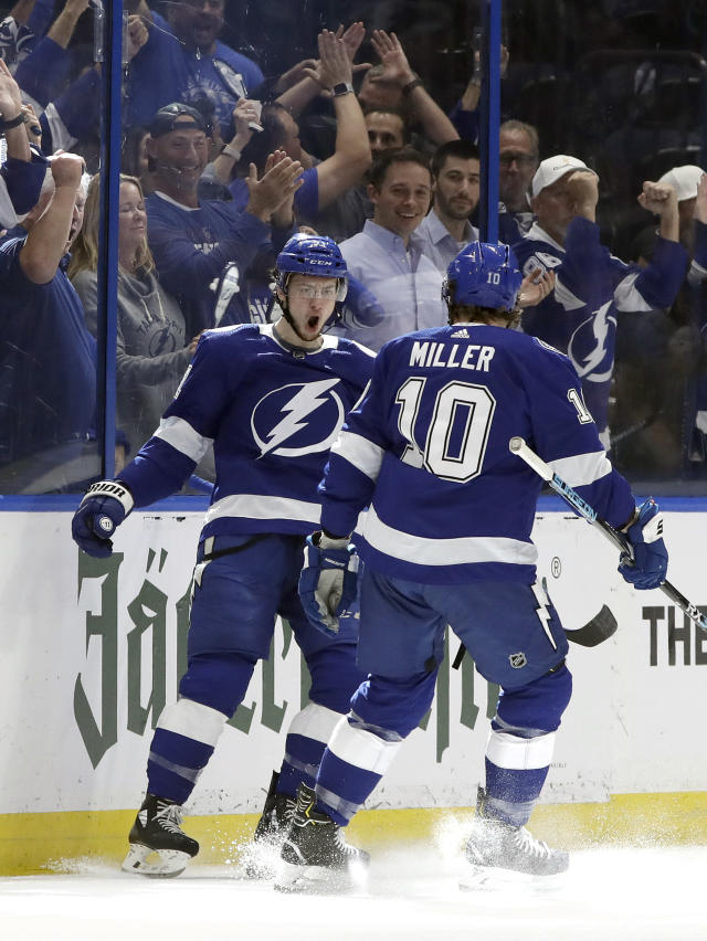 Tampa Bay Lightning center Anthony Cirelli (71) celebrates his goal against the Columbus Blue Jackets with center J.T. Miller (10) during the first period of Game 1 of an NHL Eastern Conference first-round hockey playoff series Wednesday, April 10, 2019, in Tampa, Fla. (AP Photo/Chris O'Meara)
