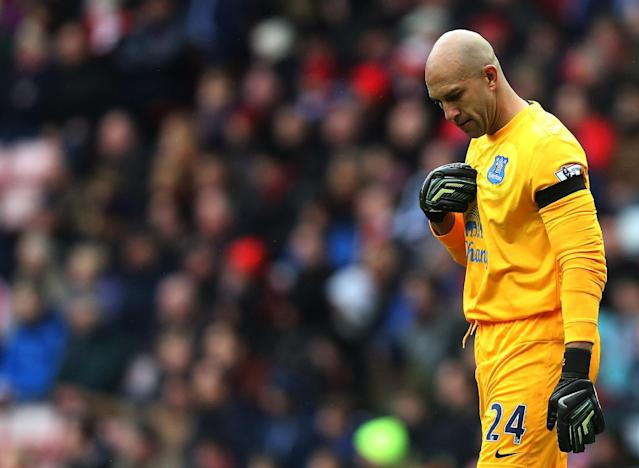 Everton's goalkeeper Tim Howard pays his respects ahead of their English Premier League soccer match at the Stadium of Light, Sunderland, England, Saturday, April 12, 2014. As a mark of respect and remembrance for those who lost their lives as a result of the Hillsborough tragedy in April 1989, all Premier League, Football League, Football Conference and FA Cup matches taking place on the weekend of 11-14 April will kick off seven minutes later than originally scheduled. (AP Photo/Scott Heppell)