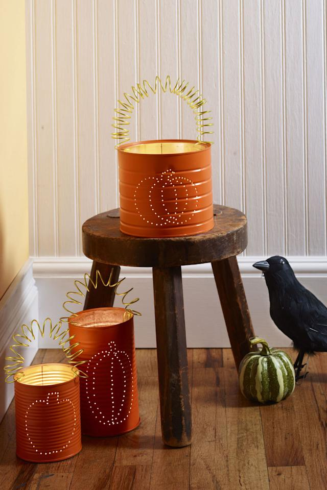 "<p><span>These embellished pumpkin cans will brighten up your porch or walkway for trick-or-treaters. </span></p><p><strong>1. </strong>Draw pumpkin design on metal can with permanent marker. Fill can with water and freeze.</p><p><strong>2. </strong>With a nail and a hammer, poke holes every <span>¼</span>"" to <span>½</span>"" along the design. Poke a hole on either side at the top for a handle.</p><p><strong>3. </strong>Once water has melted and can is dry, apply orange spray paint; let dry.</p><p><span><strong>4. </strong></span>Cut a <span>24</span>"" piece of wire and coil around the marker. Stretch out and hook into holes on sides.</p><p><strong>What you'll need: </strong><span><em>12-Gauge Embossed Apple Green Aluminum Wire ($7; <a rel=""nofollow"" href=""https://www.jamaligarden.com/embossed-aluminum-wire.html"">jamaligarden.com</a>)</em></span></p>"