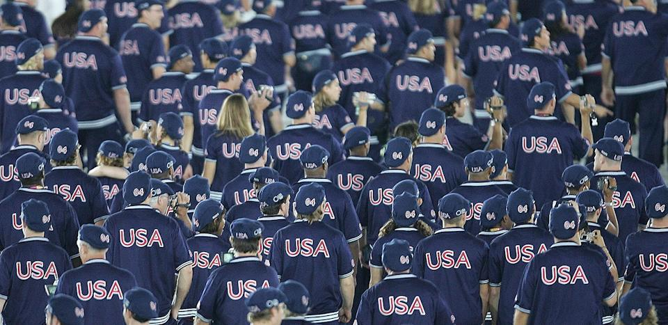 <p>Canadian brand Roots designed uniforms that were particularly fitting for 2004. The basketball warm-up jackets emblazoned with USA on the back were worn by all, while women had navy skirts and men had navy athletic pants. </p>