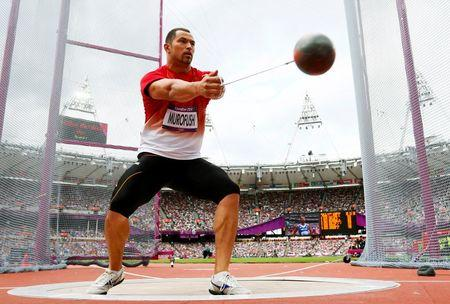 Japan's Koji Murofushi competes during Group A of the men's hammer throw qualifications in the London 2012 Olympic Games at the Olympic Stadium