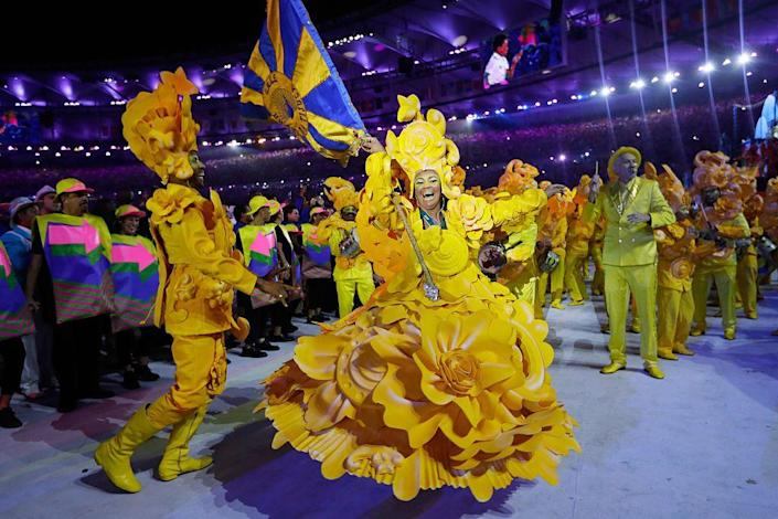 <p>Dancers dressed in bright, colorful costumes performed, as the ceremony featured Brazilian music: samba and funk carioca.</p>