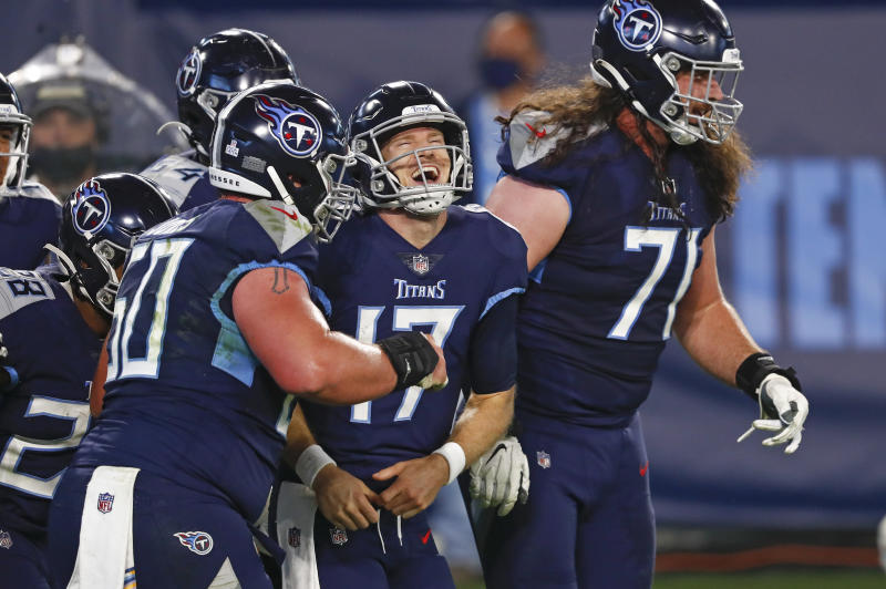 Tennessee Titans quarterback Ryan Tannehill (17) celebrates after scoring a touchdown on a 10-yard run. (AP Photo/Wade Payne)