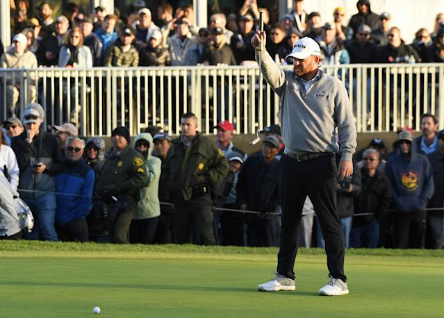 "<div class=""caption""> J.B. Holmes lines up a putt on the 18th hole green during the final round of the 2019 Genesis Open. </div> <cite class=""credit"">Harry How/Getty Images</cite>"