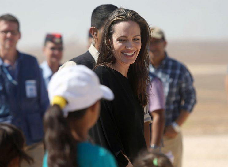 AZRAQ, JORDAN - SEPTEMBER 09: US actress and UNHCR special envoy and Goodwill Ambassador Angelina Jolie greets children during a press conference at Al- Azraq camp for Syrian refugees on September 9, 2016, in Azraq, Jordan. Jolie arrived at the camp and visited syrian families before speaking to the media. (Photo by Jordan Pix/Getty Images)
