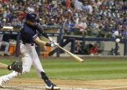 Milwaukee Brewers' Ryan Braun hits a home run during the sixth inning of a baseball game against the Atlanta Braves Monday, July 15, 2019, in Milwaukee. (AP Photo/Morry Gash)