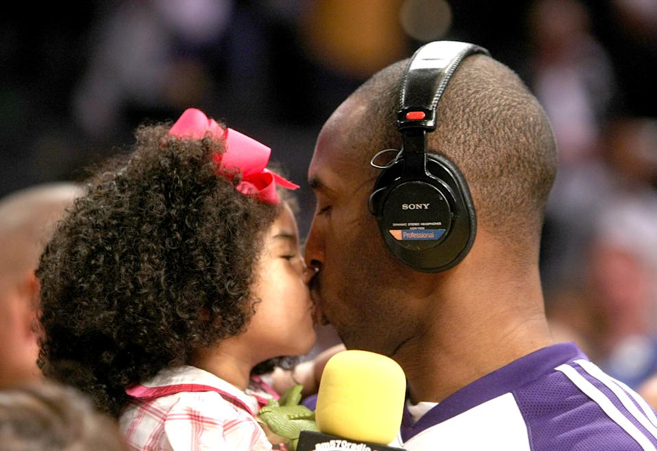 Kobe Bryant #24 of the Los Angeles Lakers kisses daughter Gianna following the game with the Memphis Grizzlies on April 12, 2009 at Staples Center in Los Angeles, California. (Photo by Stephen Dunn/Getty Images)