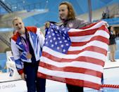 United States' Katie Ledecky, gold medalist in the women's 800-meter freestyle swimming final, right, holds an American flag during the 2012 Summer Olympics in London, Friday, Aug. 3, 2012. At just 15-years-old, Ledecky is the youngest member of the U.S. swim team. (AP Photo/Lee Jin-man)