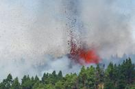 Lava and smoke are seen followng the eruption of a volcano in Spain