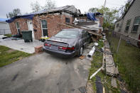 A heavily damaged home and car sit unrepaired in the aftermath of Hurricane Laura and Hurricane Delta, in Lake Charles, La., Friday, Dec. 4, 2020. (AP Photo/Gerald Herbert)