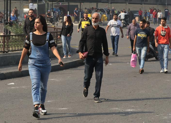 Shoppers leave Shorja, Baghdad's main shopping district, during ongoing protests, in Baghdad, Iraq, Sunday, Nov. 10, 2019. On Sunday, Amnesty International called on Iraqi authorities to immediately rein in security forces after at least six protesters were killed in central Baghdad amid a widening security crackdown. The deaths, including five by live ammunition, occurred Saturday during a police operation to clear demonstrations from several bridges and streets near Tahrir Square, the epicenter of the protests. (AP Photo/Khalid Mohammed)