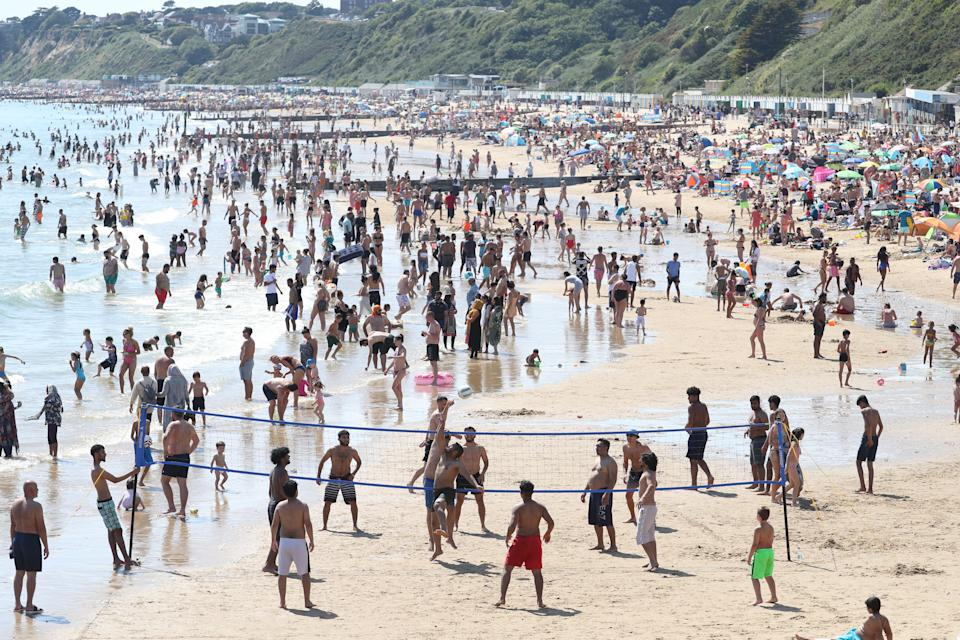 People on the beach in Bournemouth, Dorset, as the public are being reminded to practice social distancing following the relaxation of the coronavirus lockdown restrictions in England. (Photo by Andrew Matthews/PA Images via Getty Images)