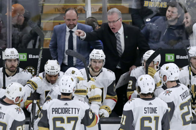 Vegas Golden Knights assistant coach Ryan McGill, right, yells at his players while head coach Peter DeBoer looks on during a timeout late in the third period of an NHL hockey game against the Boston Bruins in Boston, Tuesday, Jan. 21, 2020. The Bruins won 3-2. (AP Photo/Charles Krupa)