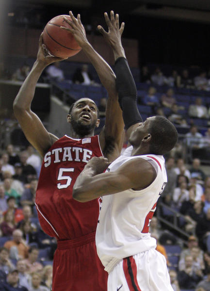North Carolina State's C.J. Leslie, left, shoots over San Diego State's Deshawn Stephens during the second half of an NCAA college basketball tournament second-round game Friday, March 16, 2012, in Columbus, Ohio. NC State won 79-65. (AP Photo/Jay LaPrete)