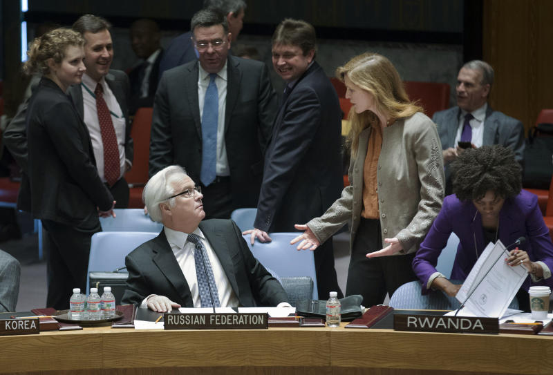 Russia's U.N. Ambassador Vitaly Churkin, left, and United States' U.N. Ambassador Samantha Power interact before an U.N. Security Council meeting on the Ukraine crisis, Saturday, March 15, 2014, at the United Nations headquarters. Russia vetoed a U.N. resolution declaring Sunday's referendum on the future of Ukraine's Crimean Peninsula illegal, but its close ally China abstained in a show of Moscow's isolation. Supporters of the U.S.-sponsored resolution knew that Russia would use its veto, but they put the resolution to a vote Saturday morning to show the strength of opposition to Moscow's takeover of Crimea. (AP Photo/John Minchillo)