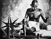 Mohandas Karamchand Gandhi with his charkha. (Photo by: Universal History Archive/ Universal Images Group via Getty Images)