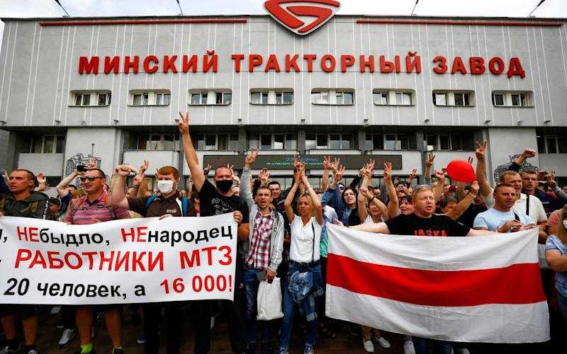 Workers of the Minsk Tractor Works protested outside the iconic plant in a major blow for Mr Lukashenko - Sergei Grits/AP