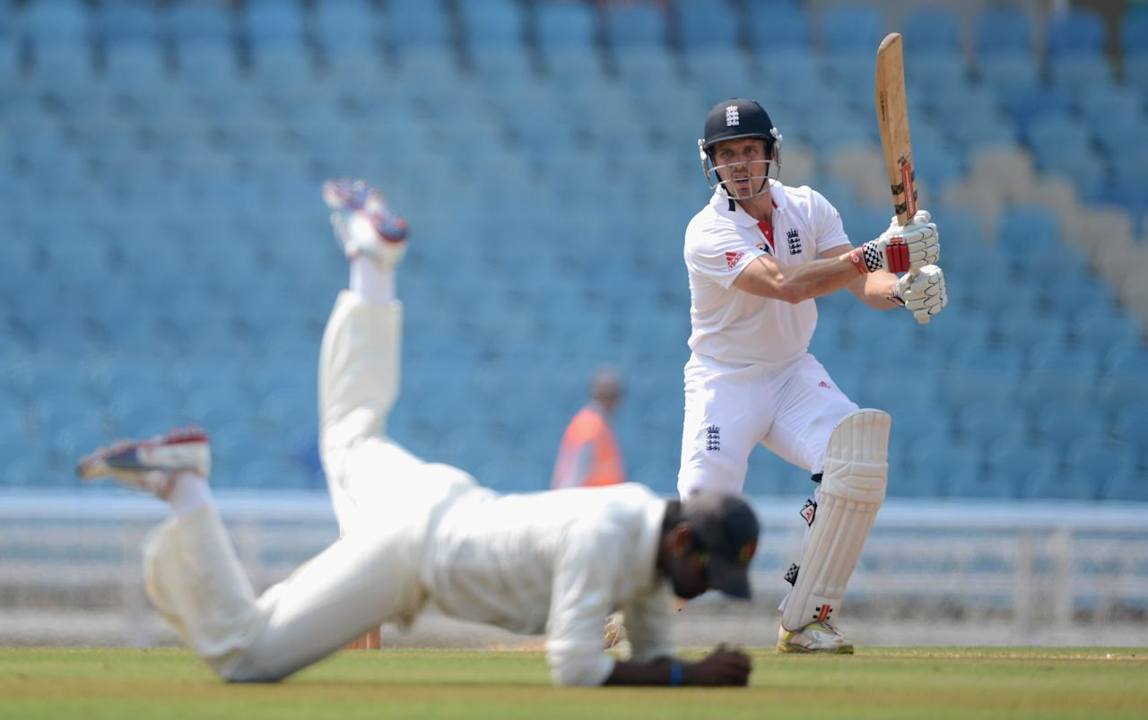 MUMBAI, INDIA - NOVEMBER 05:  Nick Compton of England hits past a Mumbai A fielder during day three of the tour match between Mumbai A and England at The Dr D.Y. Palit Sports Stadium on November 5, 2012 in Mumbai, India.  (Photo by Gareth Copley/Getty Images)
