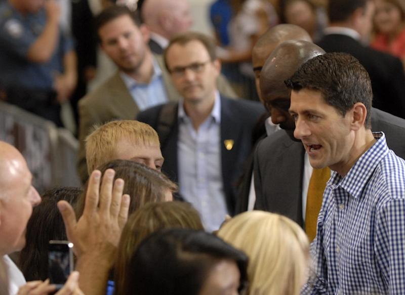 Republican vice presidential candidate, Rep. Paul Ryan, R-Wis. talks to supporters at WestPac Restorations in Colorado Springs, Colo., Thursday, Sept. 6, 2012. (AP Photo/Bryan Oller)