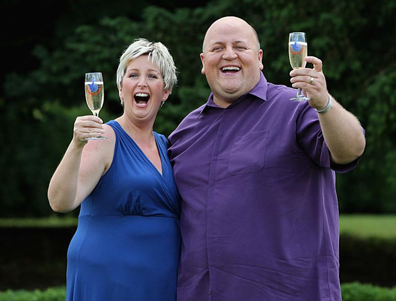 Adrian Bayford, 41, and wife Gillian, 40, from Haverhill, Suffolk, after a press conference at Down Hall Country House Hotel in Hatfield Heath, Hertfordshire, after they won £148.6 million on Friday's EuroMillions jackpot.