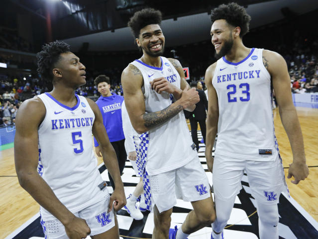 Kentucky's Immanuel Quickley (5), Nick Richards, center, and EJ Montgomery (23) smile as they leave the court after defeating Wofford in a second-round game in the NCAA mens college basketball tournament in Jacksonville, Fla., Saturday, March 23, 2019. (AP Photo/Stephen B. Morton)