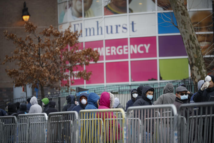 Patients wait for a COVID-19 test at Elmhurst Hospital Center, in Queens, N.Y., on March 25. (John Minchillo/AP)