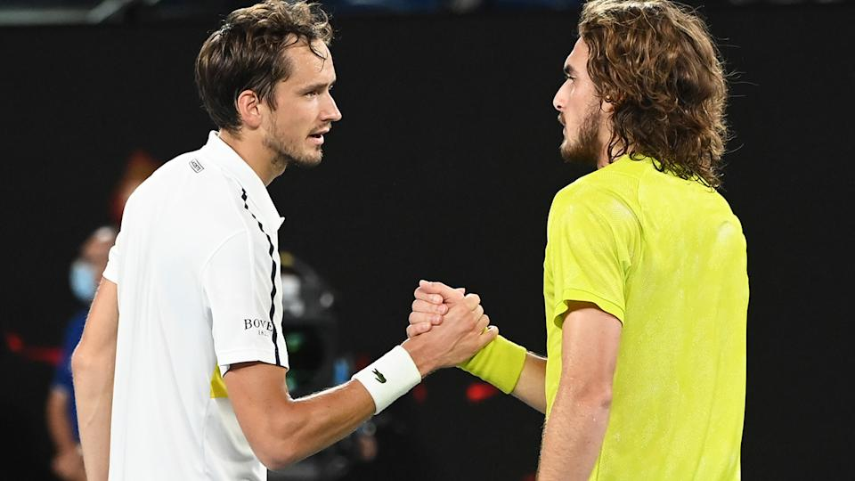 Daniil Medvedev and Stefanos Tsitsipas, pictured here after their clash at the Australian Open.
