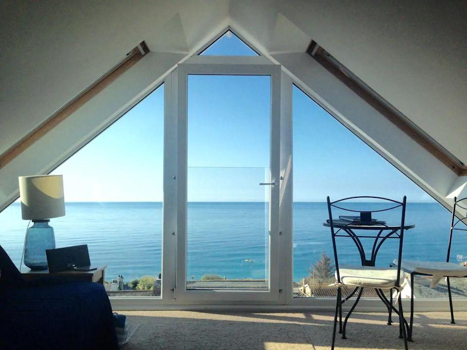 """<p>Looking for an Airbnb in Cornwall with an unbeatable sea view? This holiday cottage allows you to wake up to this spectacular scene and enjoy it from your bed. Whether you're having breakfast or watching the sunset, this loft studio is all about the view.</p><p>It's located around 200 metres from the beach so when you're not taking it in from a height, you can make the most of long, coastal walks. The perfect little couples' retreat, this Airbnb has everything you need for a mini-break on Cornwall's South East coast.</p><p><strong>Sleeps</strong>: 2</p><p><strong>Price per night:</strong> £145</p><p><strong>Why we love it:</strong> That view. We could stare at it all day long!</p><p><a class=""""link rapid-noclick-resp"""" href=""""https://www.airbnb.co.uk/rooms/13808385"""" rel=""""nofollow noopener"""" target=""""_blank"""" data-ylk=""""slk:SEE INSIDE"""">SEE INSIDE</a></p>"""