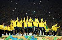 <p>Brazil line up to receive their gold medals after winning the Men's Football Final between Brazil and Germany at the Maracana Stadium on Day 15 of the Rio 2016 Olympic Games on August 20, 2016 in Rio de Janeiro, Brazil. (Photo by Lars Baron/Getty Images) </p>