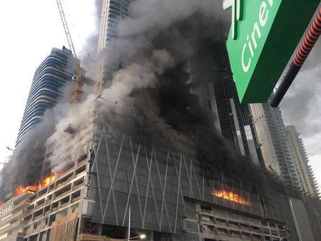 Fire is seen at a tower under construction in Dubai's Downtown district