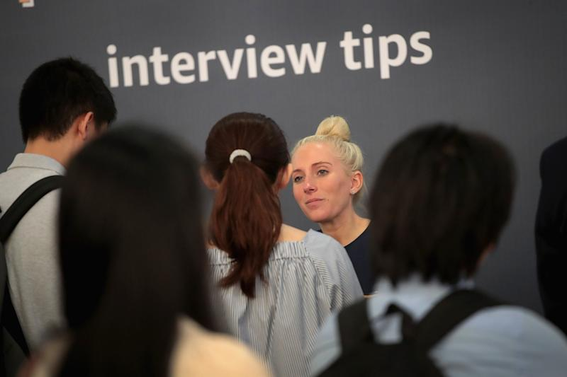 CHICAGO, ILLINOIS - SEPTEMBER 17: Job seekers are coached on interview practices with Amazon during a career fair held at Vertiport Chicago on September 17, 2019 in Chicago, Illinois. The event was one of several Amazon career fairs held across the country today as the company attempts to fill more than 30,000 full and part-time positions. (Photo by Scott Olson/Getty Images)