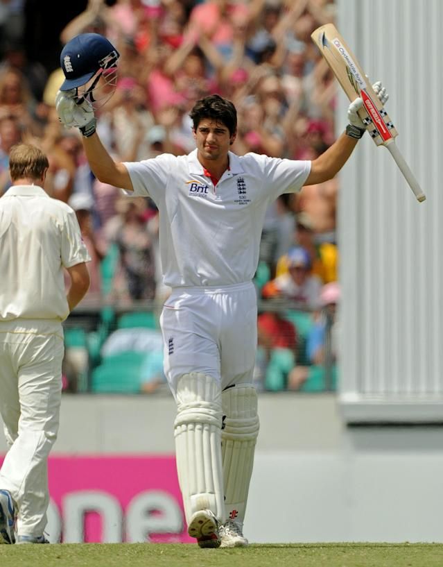 England batsman Alastair Cook raises his arms after reaching his century on day three of the fifth Ashes cricket Test against Australia at the Sydney Cricket Ground on January 5, 2011. England chasing the Australian first innings total of 280 were currently 226 for five. AFP PHOTO / Greg WOOD (Photo credit should read GREG WOOD/AFP/Getty Images)