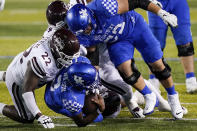 Kentucky quarterback Terry Wilson (3) is sacked by Mississippi State defensive tackle Nathan Pickering (22) and linebacker Nathaniel Watson (14) during the second half of an NCAA college football game Saturday, Oct. 10, 2020, in Lexington, Ky. (AP Photo/Bryan Woolston)